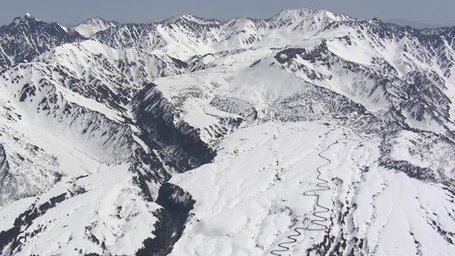 aerial, tateyama kurobe alpine route, toyama, japan - winding road stock videos & royalty-free footage