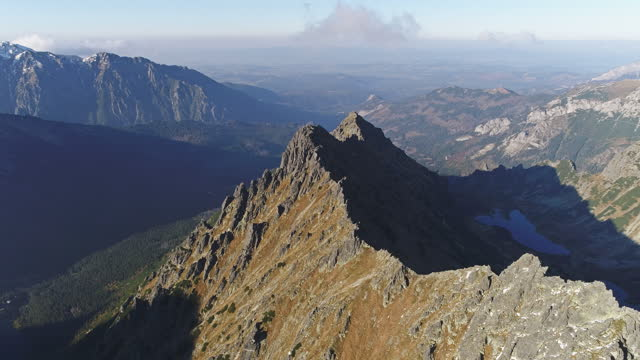 tatra mountains drone point of view. steep mountain sides covered with snow - named wilderness area stock videos & royalty-free footage