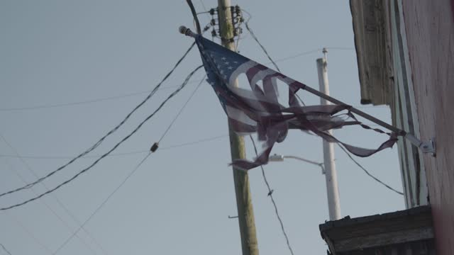 tattered american flag hangs in curtis bay during the covid-19 pandemic on april 6, 2021 in baltimore, maryland. there have been 2 170 covid-19... - atmosphere filter stock videos & royalty-free footage