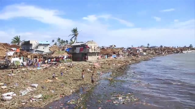 tattered lanterns festive lights and tin roofs littered towns in the central philippines on tuesday after typhoon melor swept through killing at... - littering stock videos & royalty-free footage