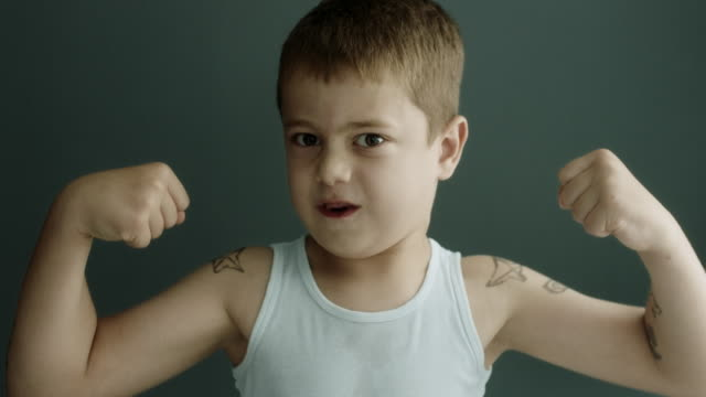 tattoed boy showing his muscle - strength stock videos & royalty-free footage