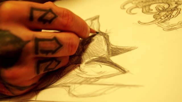 Tattoo artist drawing new sketch