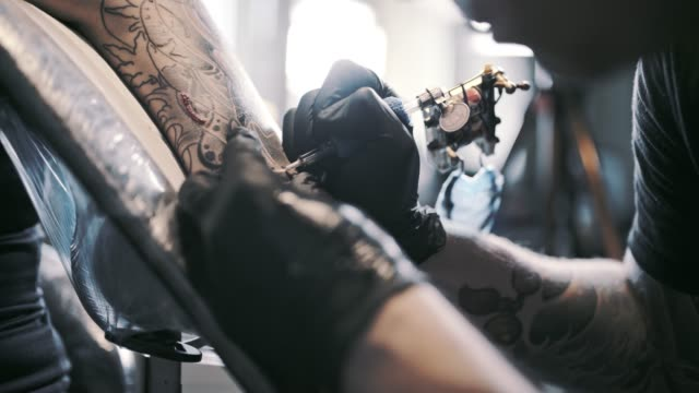 tattoo artist in action - human limb stock videos & royalty-free footage
