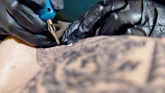 slo mo cu tattoo artist tattooing someone's arm - forearm stock videos and b-roll footage
