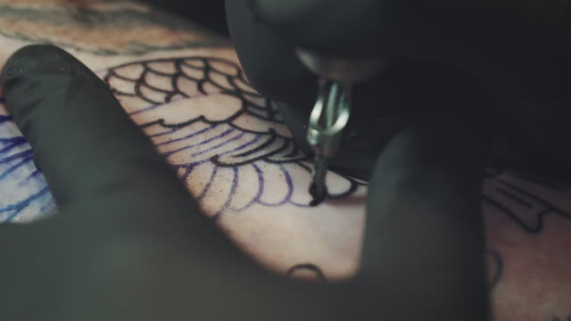 tattoo artist tattooing young woman - tattoo stock videos & royalty-free footage