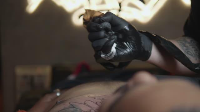 tattoo artist - polynesian ethnicity stock videos & royalty-free footage
