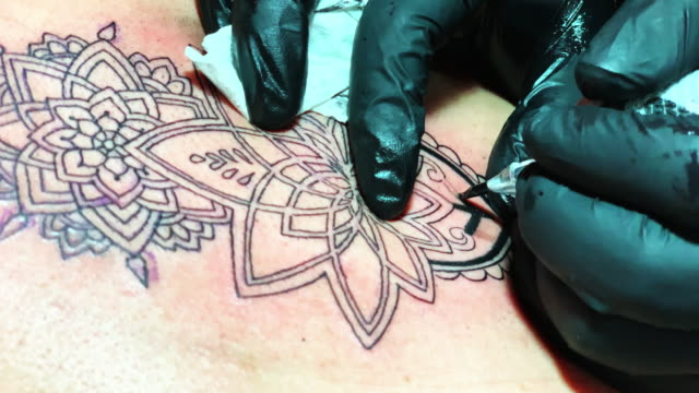 tattoo artist working at his studio - mandala stock videos & royalty-free footage