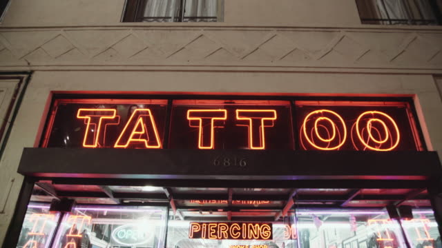 tattoo neon sign - tattoo stock videos and b-roll footage