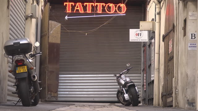 tattoo shop -  logo / fluorescent letters - tattoo stock videos and b-roll footage