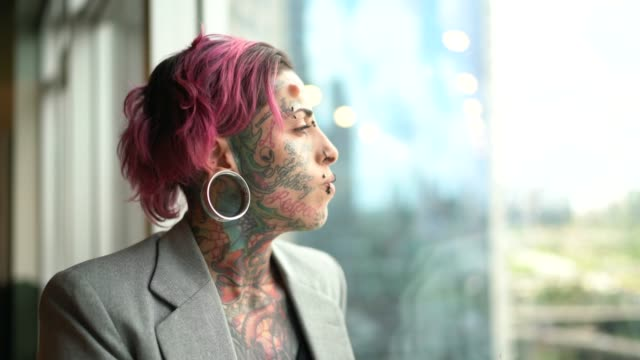 tattooed businesswoman worried looking through window at office - pierced stock videos & royalty-free footage