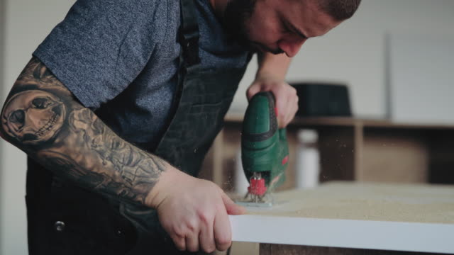 tattooed handy man drilling plank - home improvement stock videos & royalty-free footage
