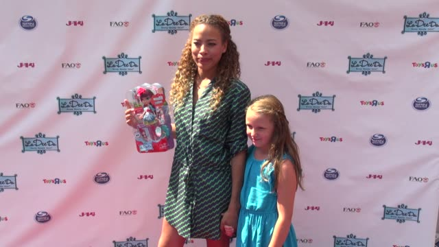 tawny cypress and her niece emma at la dee da official launch event in times square in new york 08/09/12 - tawny cypress stock videos & royalty-free footage