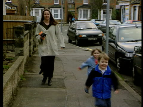 Tax allowance plans ITN Woman and two young children towards along road BV Woman and children going into house