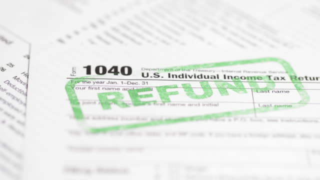 irs tax form 1040 - 4k - tax form stock videos & royalty-free footage