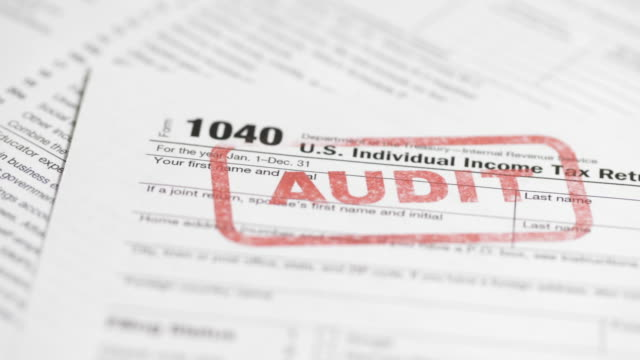 irs tax form 1040 - 4k - audit stock videos and b-roll footage
