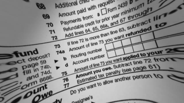 irs 1040 tax form macro - tax form stock videos & royalty-free footage