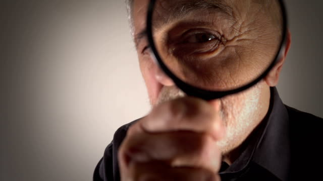 tax inspector looking through magnifying glass - curiosity stock videos & royalty-free footage