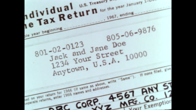/ tax return examiners at work / tax return details / workers enter tax return information onto punch cards / correcting a punch card. tax return... - tax form stock videos & royalty-free footage