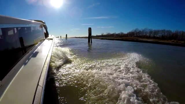 taxi boat in the venetian lagoon - traghetto video stock e b–roll