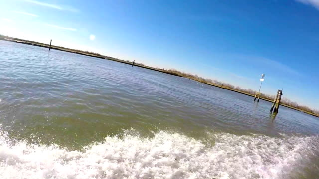 taxi boat in the venetian lagoon - wake water stock videos and b-roll footage