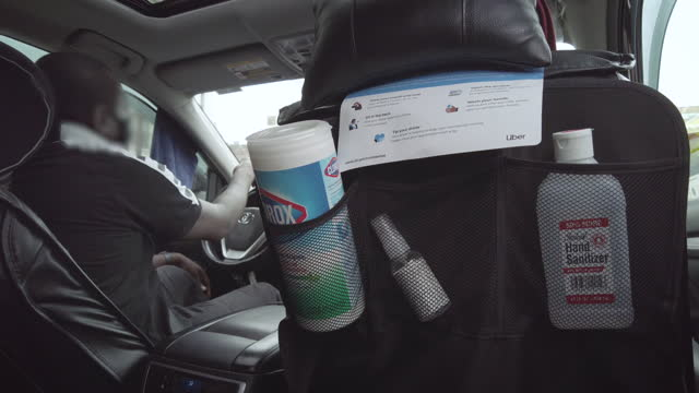 taxi cab interior backseat during coronavirus pandemic with alcohol wipes in new york city, new york on may 3, 2021. the driver's face has been... - passenger seat stock videos & royalty-free footage