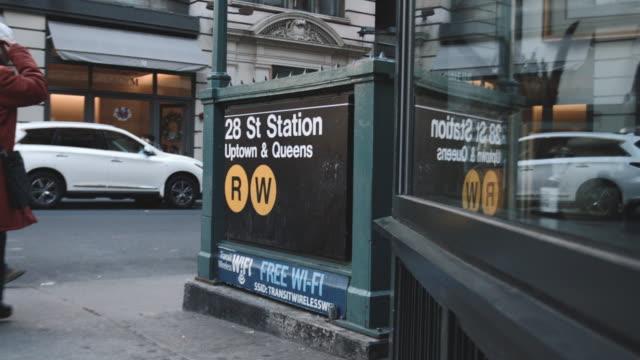 taxi cab passing new york city's 28th street subway station - huva bildbanksvideor och videomaterial från bakom kulisserna