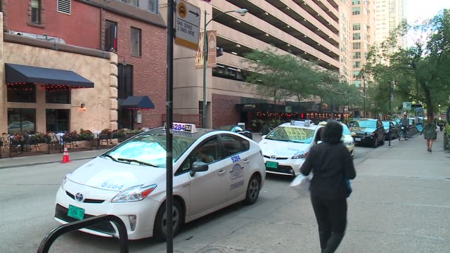 wgn taxi cabs at a taxi stand in chicago on september 30 2015 - taxi stand stock videos and b-roll footage