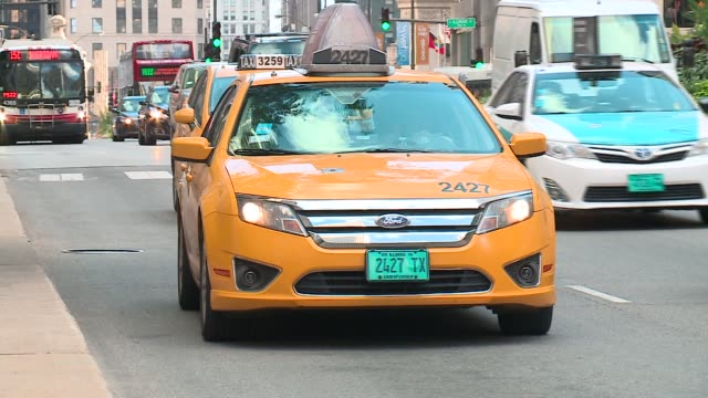 taxi cabs driving around downtown chicago streets on september 30, 2015. - yellow taxi stock videos & royalty-free footage