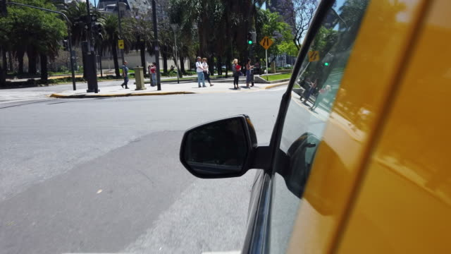 taxi car driving in buenos aires, turning left - yellow taxi stock videos & royalty-free footage