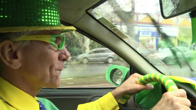 A taxi driver in Porto Alegre has decorated his car to resemble a giant Brazilian flag and he even wears an entire yellow and green uniform to match