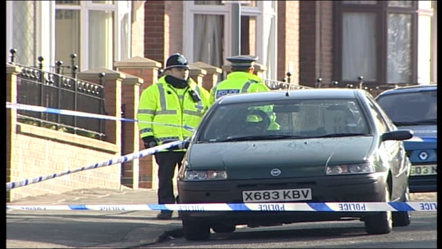 taxi driver shot dead in sheffield england yorkshire sheffield ext various of police officers behind cordon close to scene where taxi driver younis... - sheffield stock videos and b-roll footage