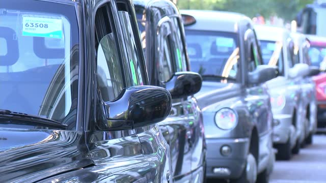 taxi drivers go to court over road closures; england: london: ext various of large number of london taxi cabs along streets. - itv london lunchtime news stock videos & royalty-free footage