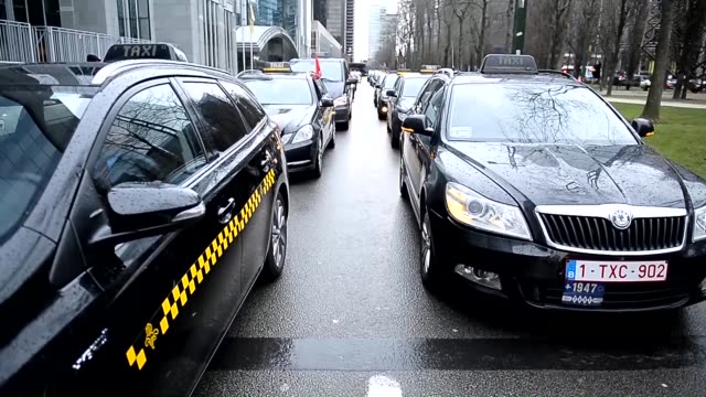 taxi drivers hold a demonstration against the mobile device application taxi booking service 'uber' and the proposed taxi plans by the brussels... - taxi stock videos & royalty-free footage