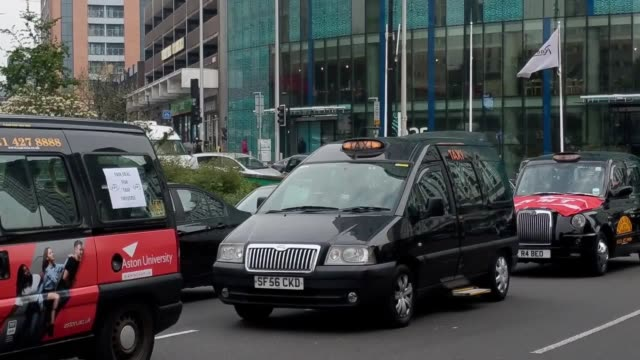 taxi drivers in birmingham stage a go slow protest linked to the clean air zone in the city centre, brought in my birmingham city council. the... - taxi stock videos & royalty-free footage
