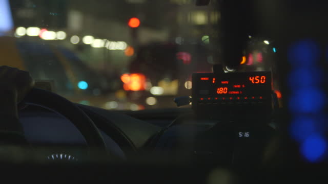 nyc taxi driving passenger, fare rising, shot from backseat - taxi stock videos & royalty-free footage