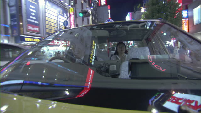 CU Taxi driving through downtown street at night / Tokyo, Tokyo Prefecture, Japan