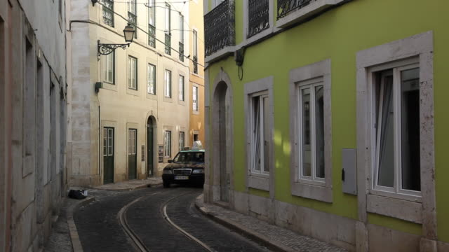 ws taxi in narrow alley / lisbon, portugal - narrow stock videos and b-roll footage