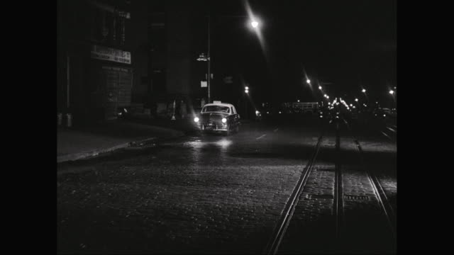 ws taxi moving on street at night / new york city, new york state, united states - cobblestone stock videos & royalty-free footage