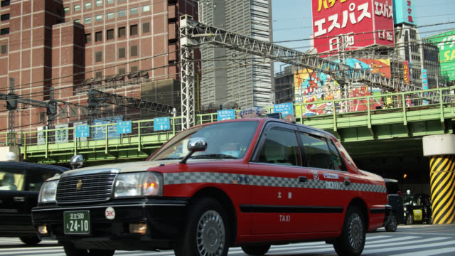 taxi near shinjuku station, japan - slow motion - taxi stock videos & royalty-free footage