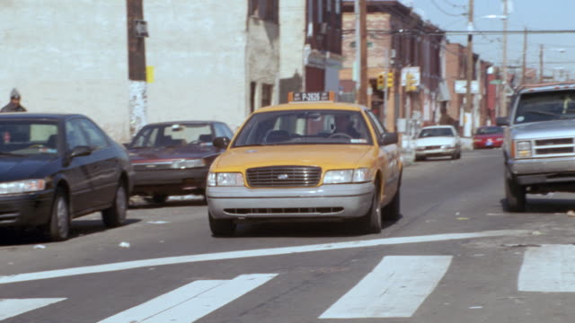 a taxi passes through a back street in south philadelphia, pennsylvania. - 2002 stock videos & royalty-free footage