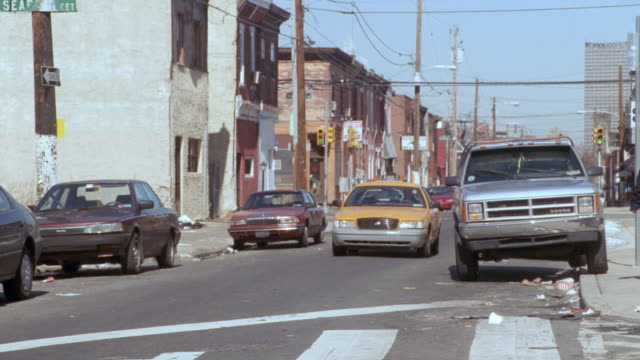a taxi passes through a back street in south philadelphia, pennsylvania. - apt stock videos & royalty-free footage