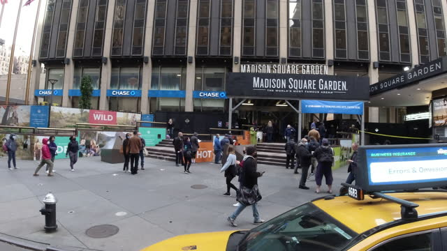 taxi, police and long lines of people wearing face mask waiting to vote on the us presidential election outside the madison square garden amid the 2020 global coronavirus pandemic. - news event stock videos & royalty-free footage