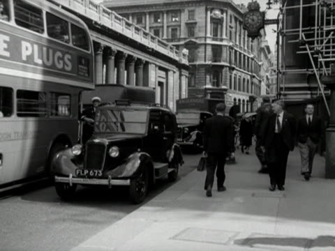 a taxi pulls out into slow moving traffic near mansion house - 1949 stock videos and b-roll footage