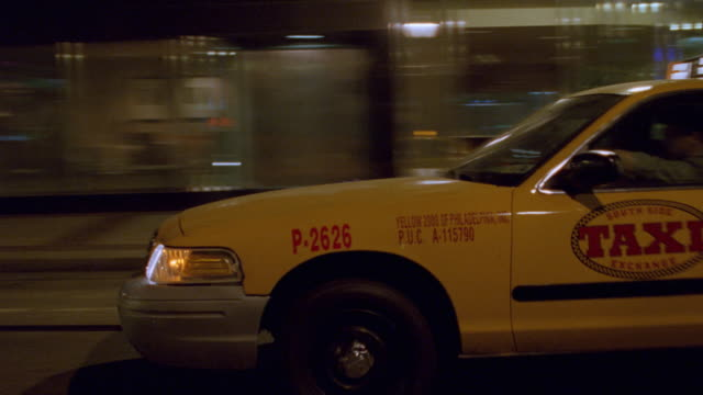 a taxi turns onto a lonely philadelphia street at night. - 2002 stock videos & royalty-free footage