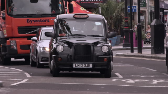 taxi waiting at a light in london - taxi stock videos & royalty-free footage