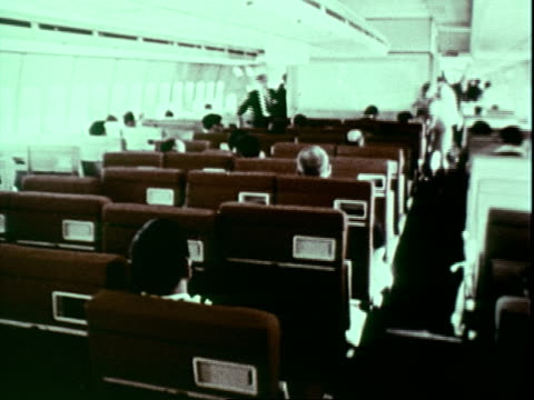taxiing, newsreel cameramen filming / passengers and crew scattered about main cabin; 747 taking off. boeing 747 is launched on january 01, 1969 - 1969 stock videos & royalty-free footage