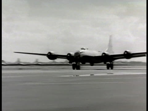 Taxiing on runway TRACKING LEFT B29 taking off heavy slow ascent