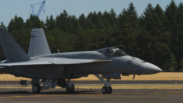 f-18 taxiing on tarmac, cockpit hatch opening - airfield stock videos & royalty-free footage