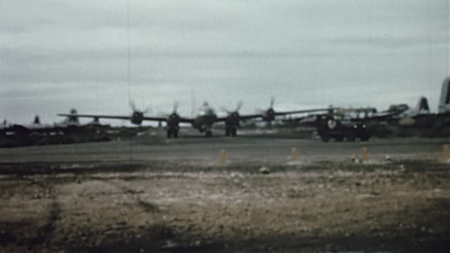 ts taxiing usaaf b29 superfortress being led by jeep across airfield during wwii - taxiway stock-videos und b-roll-filmmaterial