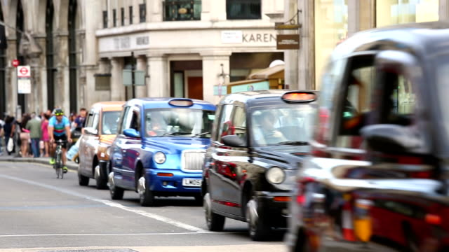 taxis and busses in london, england - city of london stock videos & royalty-free footage